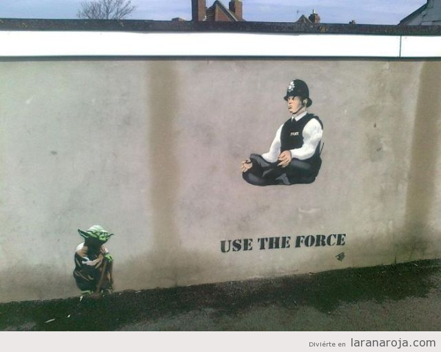Street Art del Mastro Yoda yu policía, Use the force